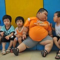 Un enfant pesant 60 kg